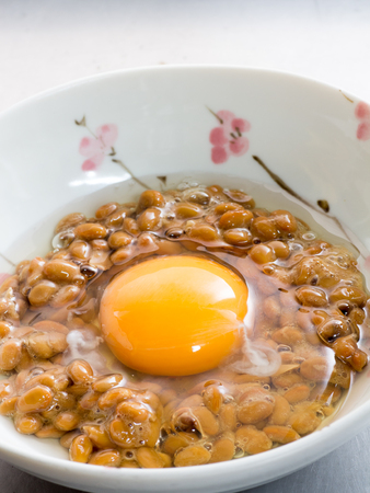 Japanese cuisine, fermented soybeans called Natto with a raw egg Stock Photo
