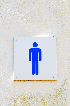 Male gender sign of bathroom on the wall