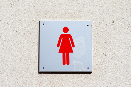 Female gender sign of bathroom on the wall
