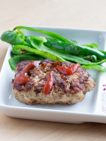 meatloaf: Japanese cuisine, homemade meatloaf with ketchup and fried green peppers