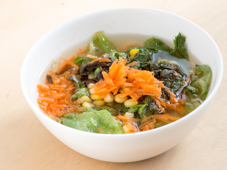 Homemade vegetable soup contains carrots, corns, lettuce Stock Photo