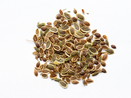 Dill seed on white isolated background Imagens