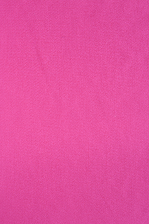 Surface of vivid pink synthetic fabric