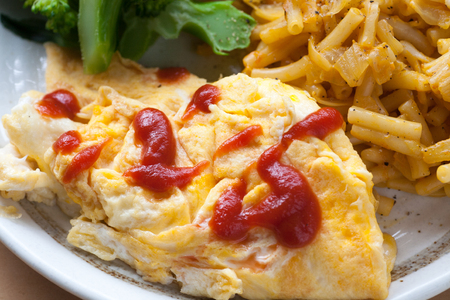Fresh omelette with ketchup Stock Photo