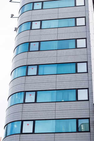 Modern building surface with patterned windows in Japan