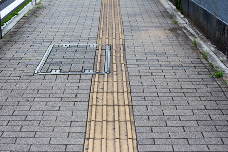 Japanese guidance, warning tile blocks for the visually impaired people on the street