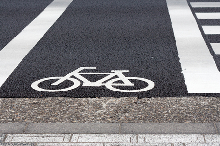 white painting sign indicating  the lane  for bicycles on the road