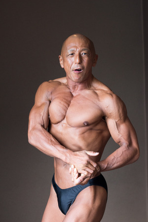 Japanese bulky bald head male 50s bodybuider posing side chest