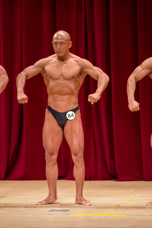 Japanese bulky bald head male 50s bodybuider posing front relax