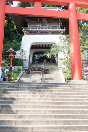 KANAGAWA, JAPAN - JULY 22, 2018: The entrance of the Enoshima shopping street in summer early morning: The gate of Enoshima shrine in summer early morning