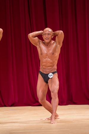 Japanese bulky bald head male 50s bodybuider posing abdominal and thigh