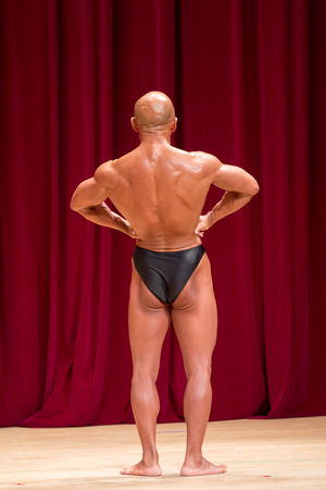 Japanese bulky bald head male 50s bodybuider posing back lat spread Stock Photo