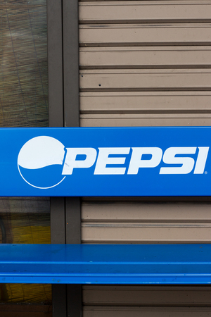 Ibaraki, Japan - JULY 7, 2018: PEPSI advertising plastic blue bench in front of ashop