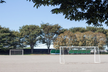 Small football park in city in late summer