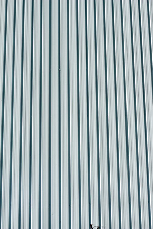 Stripped blue metal wall