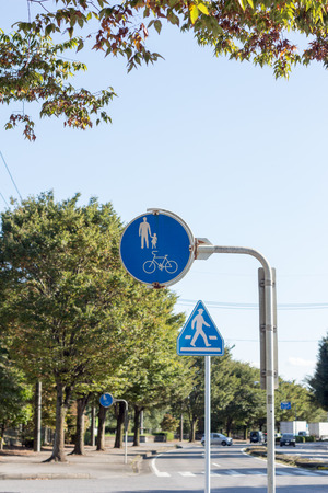 Japanese traffic sign for pedestrian and bike in late summer Stock Photo