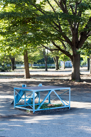 Small blue platform for speech in Japanese park Stock Photo