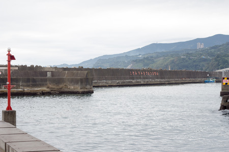 Breakwater, seawall on cold cloudy day in Japan