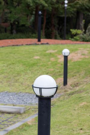White round shaped garden lights in the daytime at garden