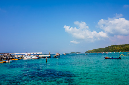 Koh Larn, Thailand - June 15, 2016: Colorful blue and green sea with blue sky on summer season, selective focus