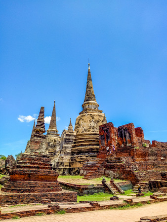 Ancient pagoda history of Wat Prasrisanpet against blue sky in Ayutthaya historical park,Thailand. it is very popular with tourists and foreigners - colorful style Stock Photo