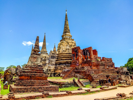 foreigners: Ancient pagoda history of Wat Prasrisanpet against blue sky in Ayutthaya historical park,Thailand. it is very popular with tourists and foreigners - colorful style Stock Photo