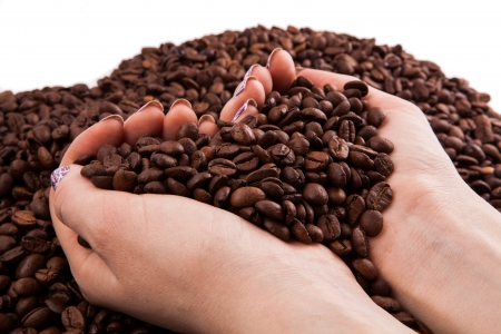 nosh: a handful of coffee beans Stock Photo