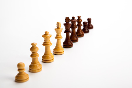 Number of chess pieces on white background photo