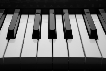 black and white keys of the piano closeup photo