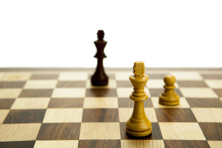 adversary: chess pieces on the board on white background Stock Photo