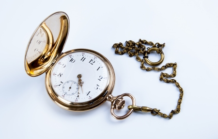 dispositions: Gold pocket watch on white background close-up Stock Photo