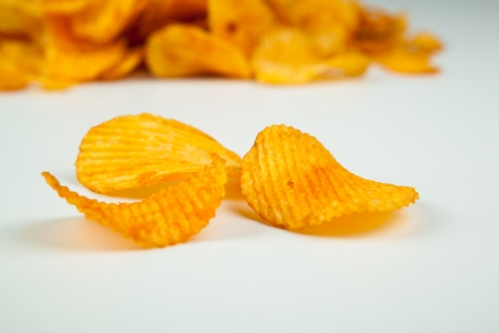 nosh: handful of potato chips close-up