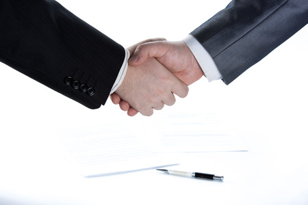 headway: signing of the agreement and a handshake on white