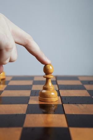 throwaway: hand of man making a move chess figure
