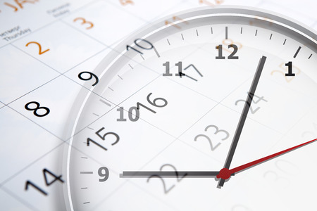 digital clock: sheet of a calendar with the number of days and clock close-up Stock Photo