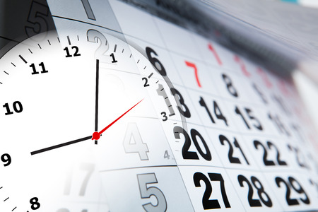 wall calendar calendar with the number of days and clock close-up photo