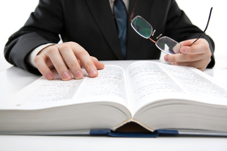man is looking for information in the dictionary close-up