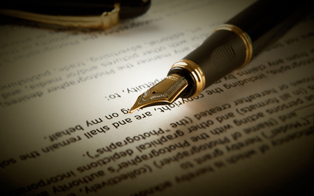 treatise: fountain pen on text sheet paper close-up Stock Photo
