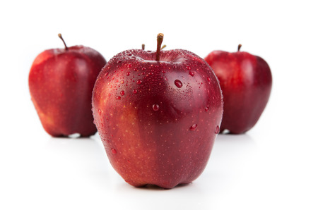 maroon apples closeup on a white background