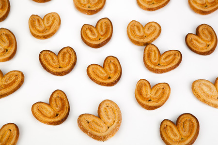 nosh: cookies of puff pastry in the shape of hearts close-up Stock Photo