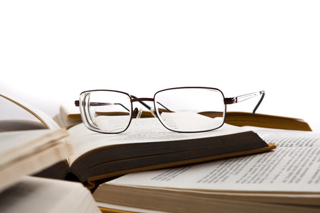 Eye glasses on the books isolated on a white Reklamní fotografie