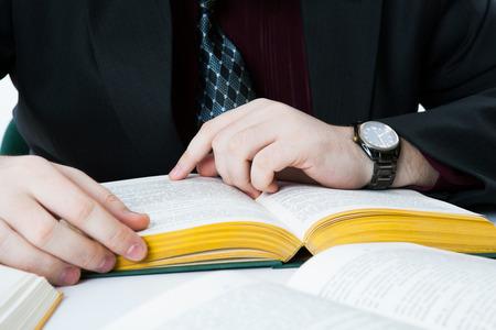 undergrad: mans hands on an open book close-up