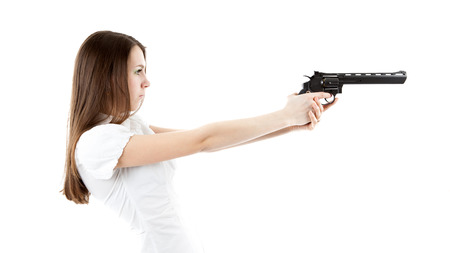 young girl holding a pistol isolated on a white background photo