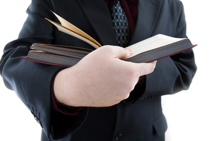 undergrad: man holding an open book close-up on a white Stock Photo