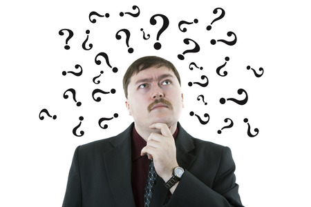 portrait of a man thinking question with question symbols on a white background