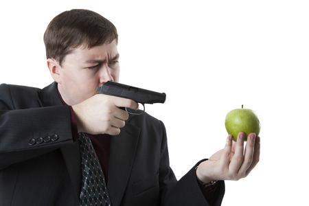 doldrums: man aims at the apple on his hand on a white background
