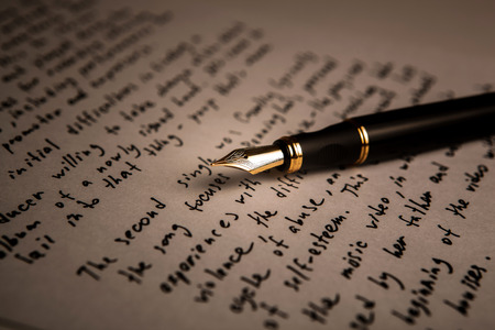 fountain pen on text sheet paper closeup Stock Photo