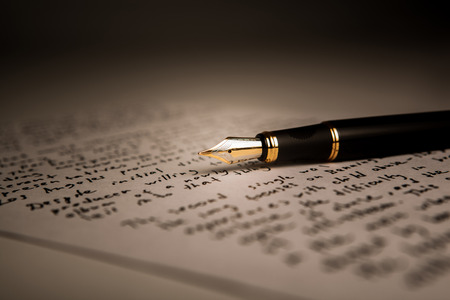 prose: fountain pen on text sheet paper closeup Stock Photo