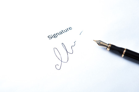 pen and signature on a white closeup Stock Photo - 27997165