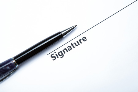 dispositions: pen and signature on a white closeup